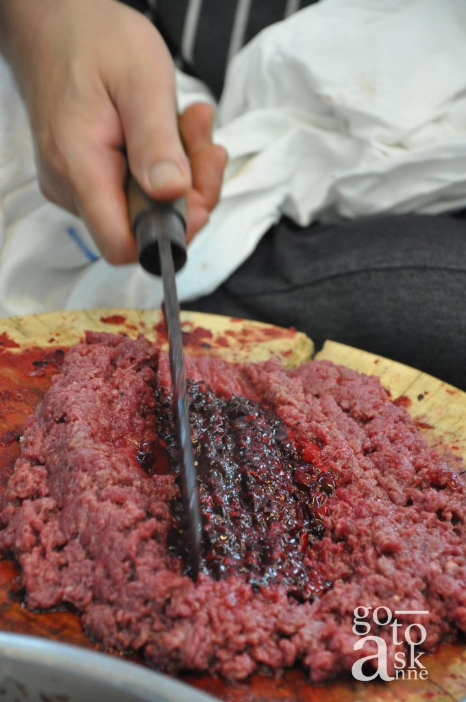 Minced pork with blood jelly; preparing for Laab