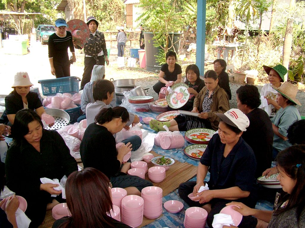 All house maids in a village helping each other to clean up temporary kitchen area.