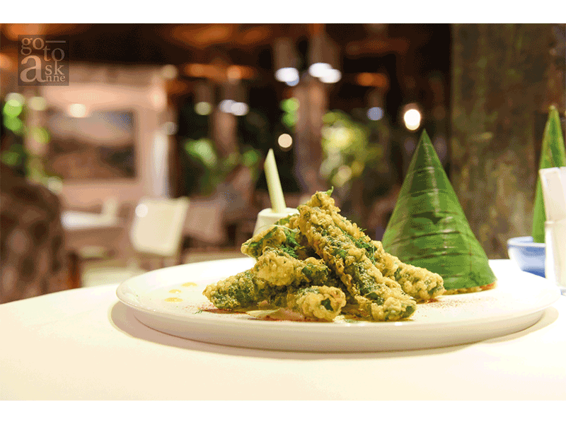 """""""Deep fried pork wrapped in betel nut leaves served with lemongrass sauce."""""""